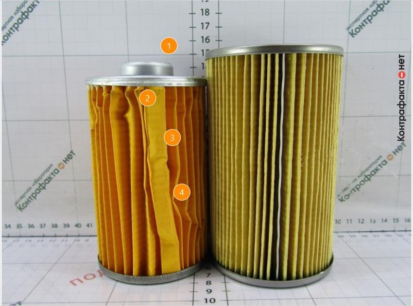 1. Картридж фильтра меньшей высоты.   2. Отсутствует металлический зажим.   3. Оттенок фильтра не соответствует оригиналу.   4. Замяты ламели.