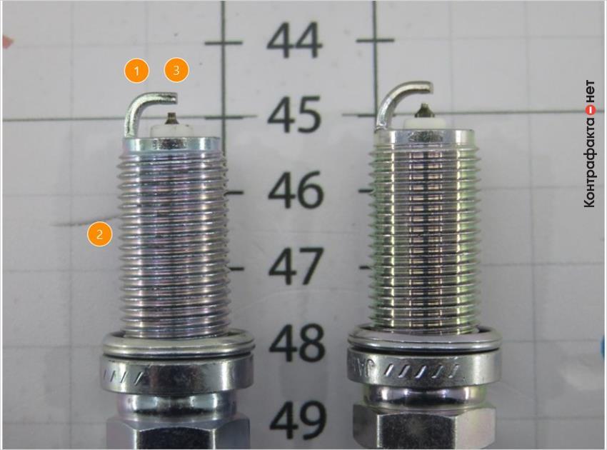1. Отличается изгиб бокового электрода. | 2. Светлый оттенок металла. | 3. Расстояние между центральным электродом и боковым визуально меньше.
