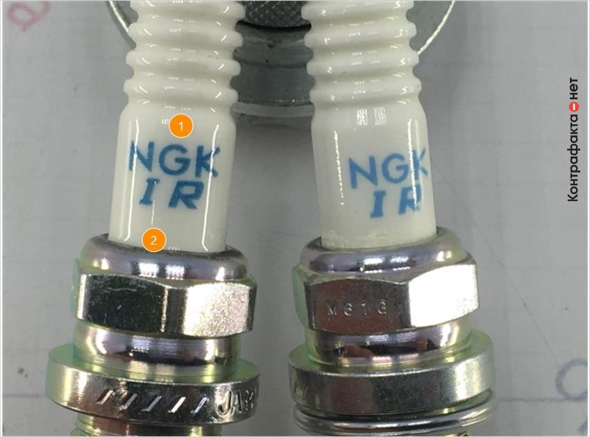 1. Отличается шрифт и качество нанесение маркировок. | 2. На соединении изолятора и корпуса отсутствует керамический порошок.