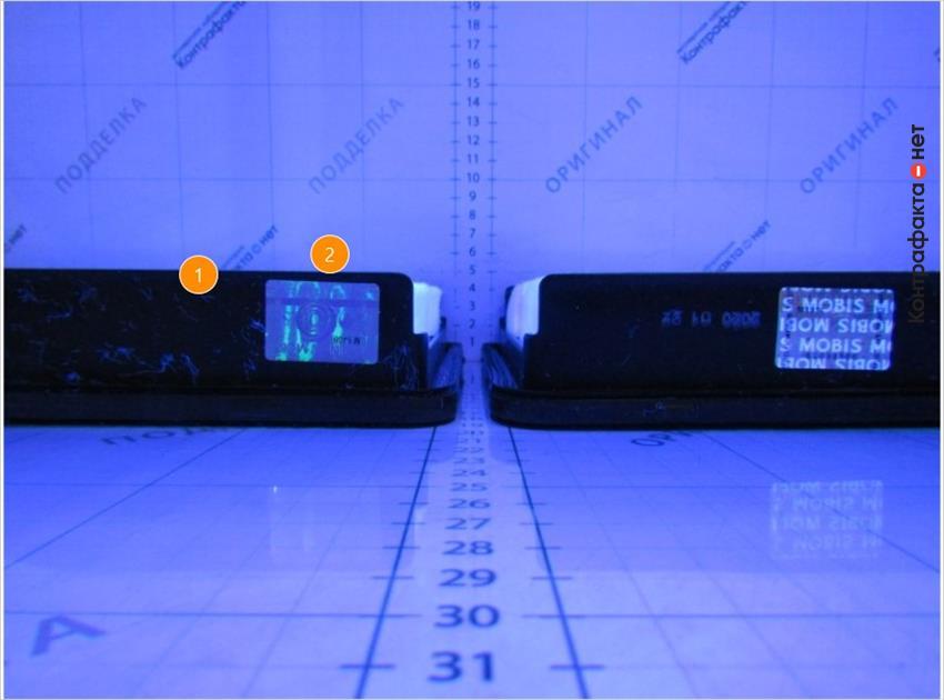 1. Нет отметки отк. | 2. В ультрафиолетовом свете не видно надпись mobis.