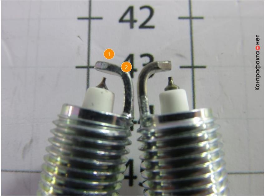 1. Боковой электрод другой формы. | 2. Отсутствует платиновое напыление.