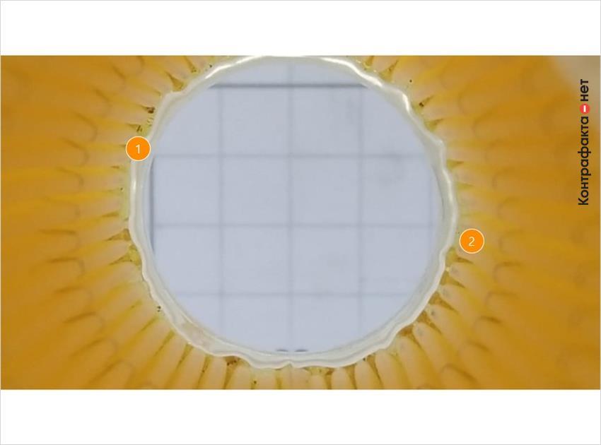 1. Многочисленные подтеки клея. | 2. Тонкая фильтровальная бумага просвечивается на свету.