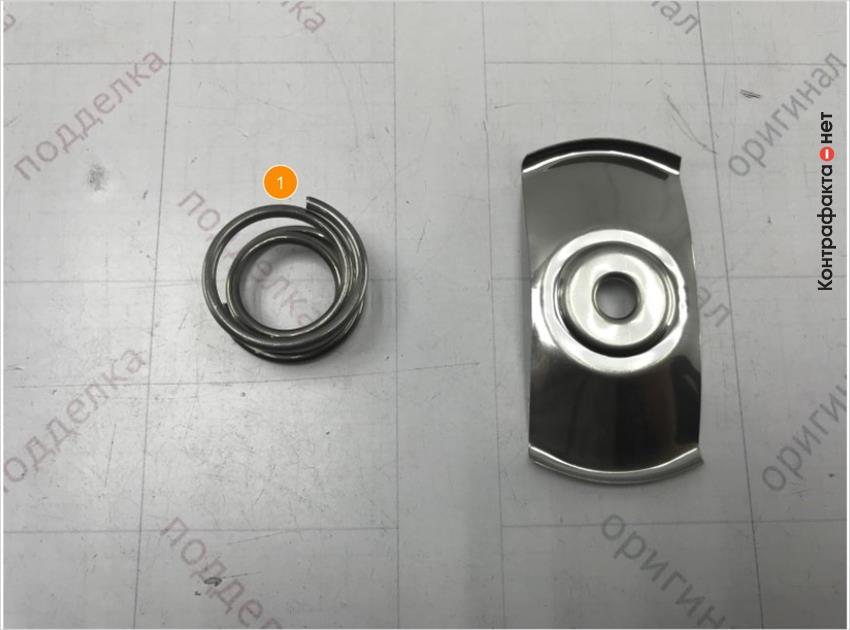 1. В оригинале вместо пружины использована прижимная пластина.