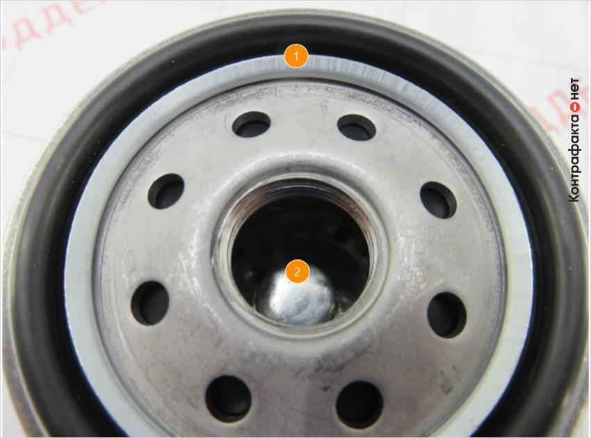 1. Конструктивное отличие крышки. | 2. Обводной клапан другой формы.