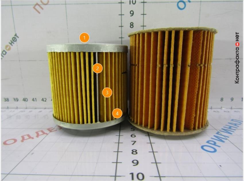 1. Меньшая высота фильтрующего элемента. | 2. При фиксации ламелей используется прижимная пластина. | 3. Количество ламелей 59 ( у оригинала 41). | 4. Металлическое основание фильтрующего элемента.
