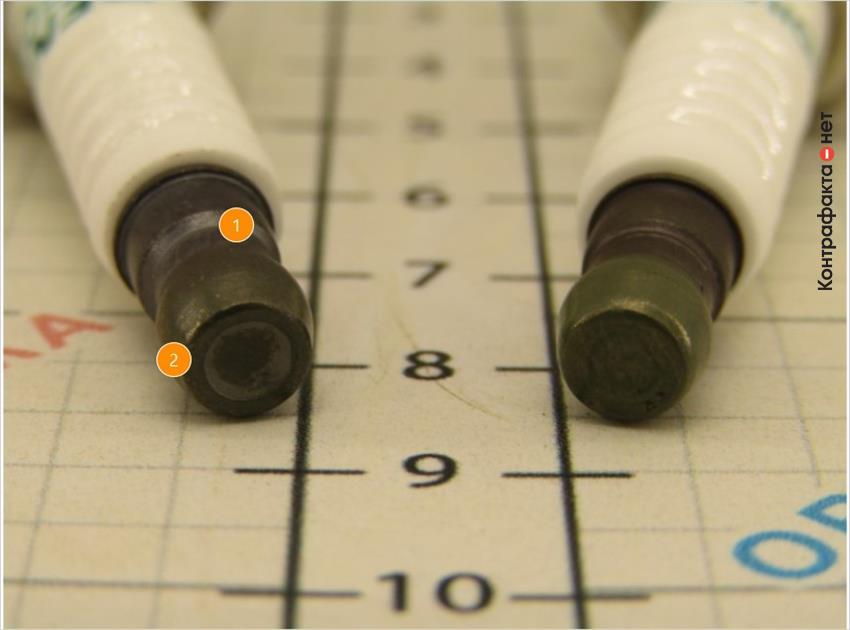 1. Более темный оттенок контактной гайки.   2. Углубление большего размера.