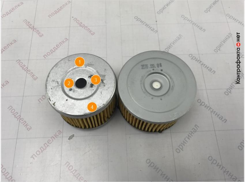 1. Отсутствует маркировка. | 2. Имеет конструктивное отличие. | 3. Отличается оттенок цвета металла. | 4. Отличается размер фильтра.