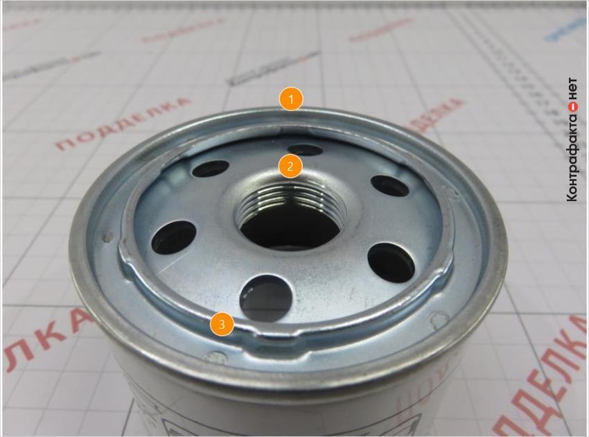1. Конструкция фильтра не соответствует оригиналу. | 2. Резьба с большим количеством витков. | 3. Отличается метод крепления крышки, используется точечная сварка.