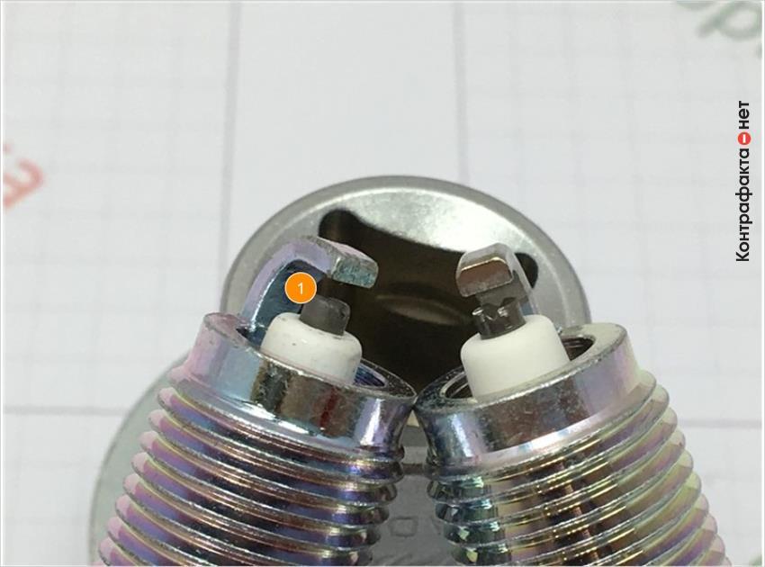 1. Отличается центральный электрод, цветовой оттенок металла сердечника не соответствует оригиналу.