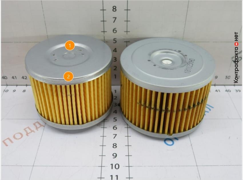 1. Конструктивное отличие обводного клапана. | 2. Фильтрующий элемент меньшего размера.