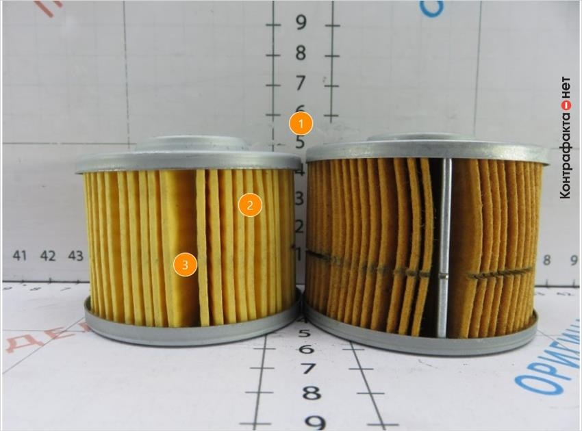 1. Картридж фильтра меньшей высоты. | 2. Количество ламелей 52, у оригинала 55. | 3. Ламели склеены между собой, в оригинале скреплены металлическим зажимом.