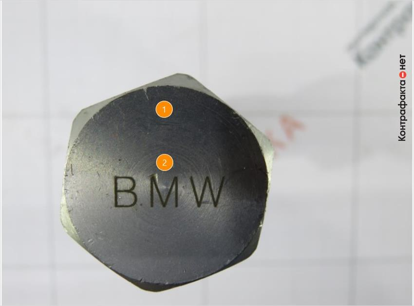 1. Конструктивные отличия головки болта, отсутствует фаска. | 2. Лишняя маркировка производителя.