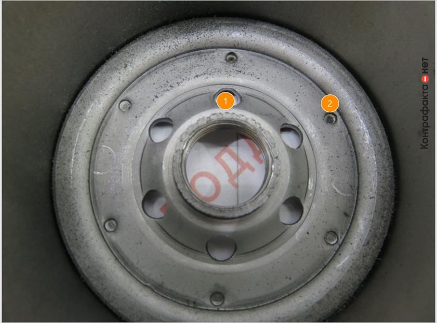 1. Остатки метала после накатки резьбы. | 2. Большое литое ядро.