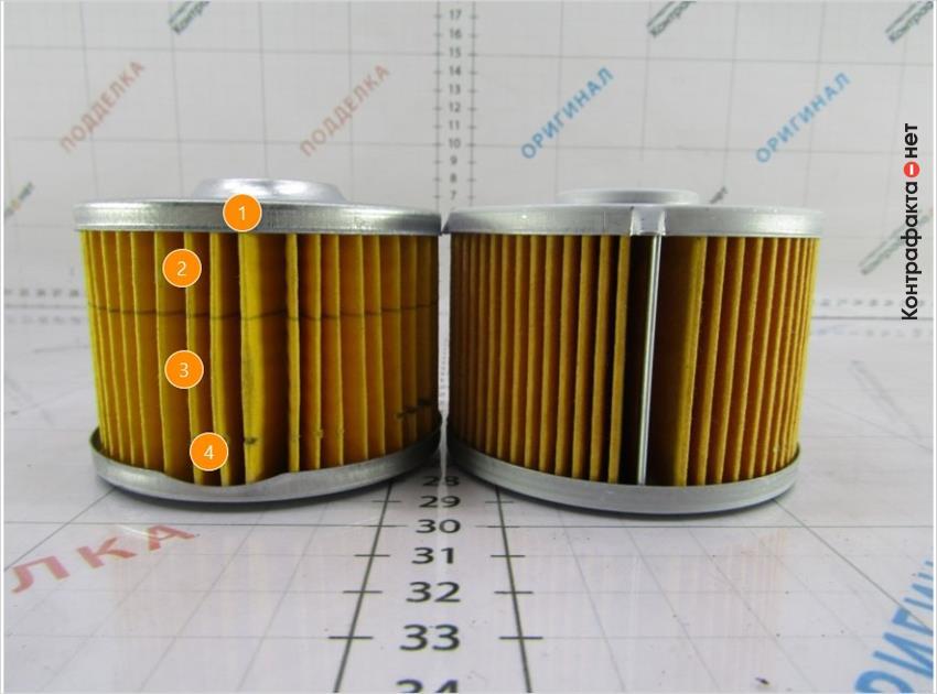 1. Ламели склеены между собой, в оригинале скреплены металлическим зажимом. | 2. Оттенок фильтра не соответствует оригиналу. | 3. Используется 40 ламелей, в оригинале 56. | 4. Крышка картриджа другой формы.