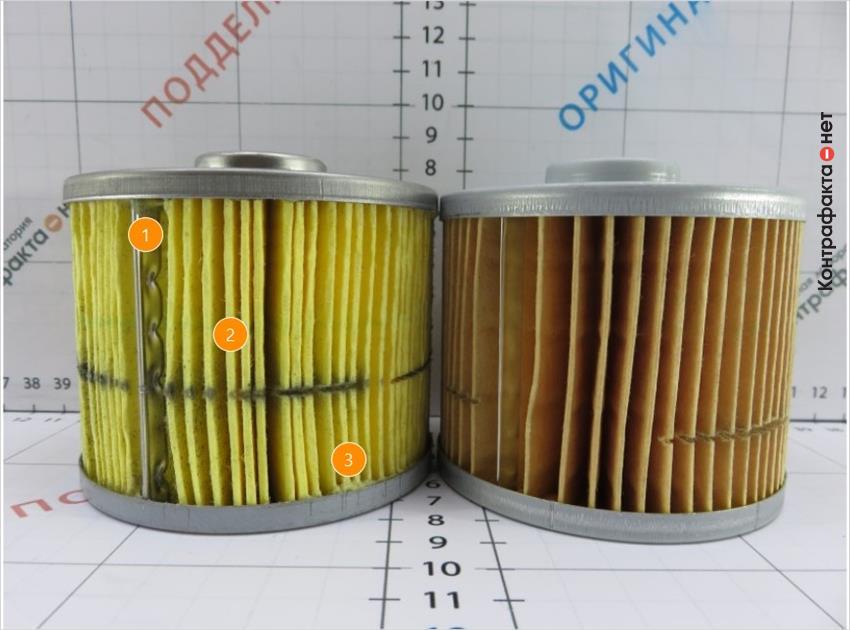 1. Отличается зажим соединительной пластины. | 2. Светлый оттенок фильтрующей бумаги. | 3. Подтеки клея.