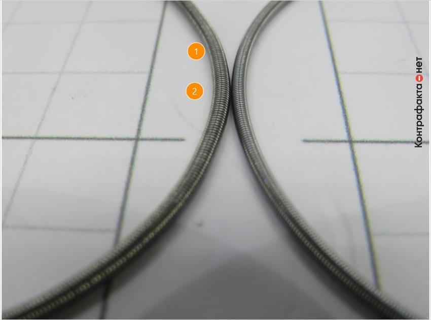1. Внешний диаметр пружины больше. | 2. Более тёмный оттенок металла.
