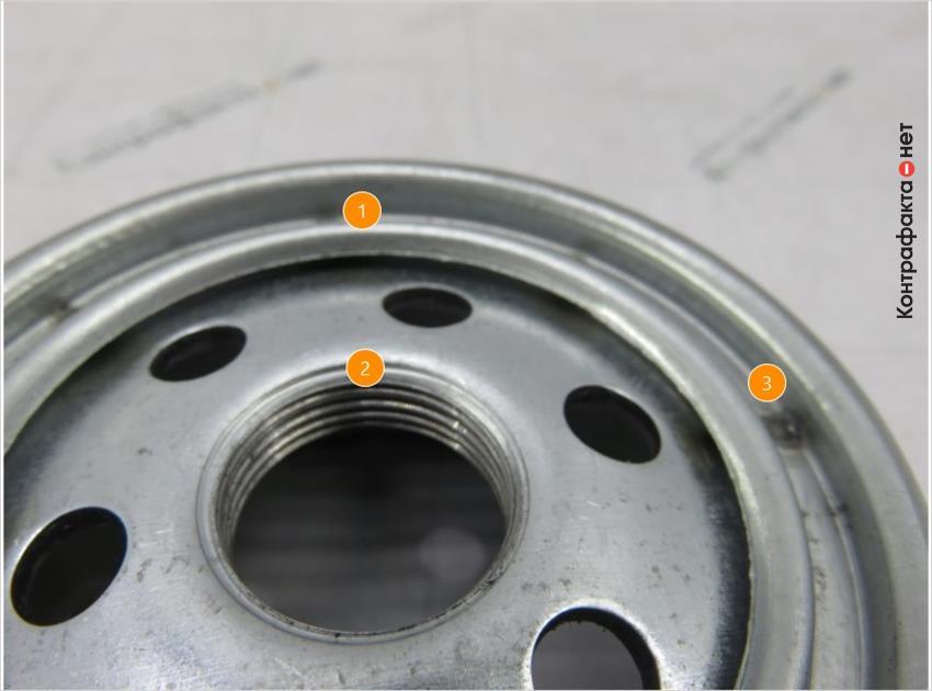 1. Конструкция фильтра не соответствует оригиналу. | 2. Черновины по всей поверхности витков внутренней резьбы. | 3. Отличается метод крепления крышки, используется точечная сварка.