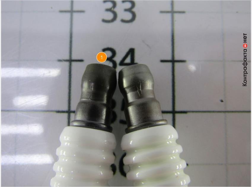 1. Контактный наконечник темного оттенка.