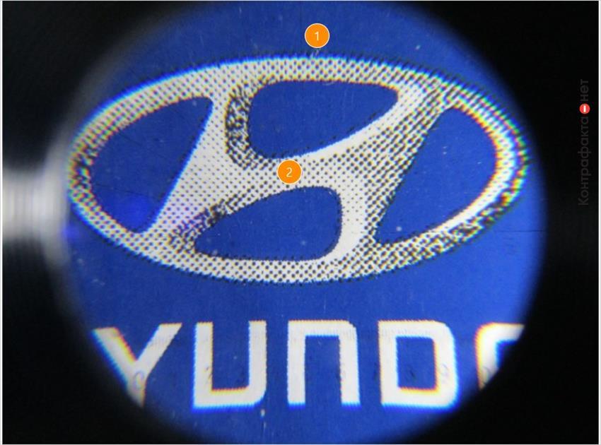 1. Изображение логотипа не выдержано в корпоративном стиле. | 2. Полиграфия низкого качества.