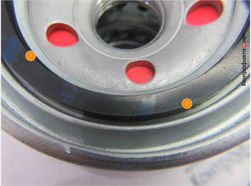 1. Кольцо другой формы. | 2. Зазор уплотнительного кольца на посадочном месте.