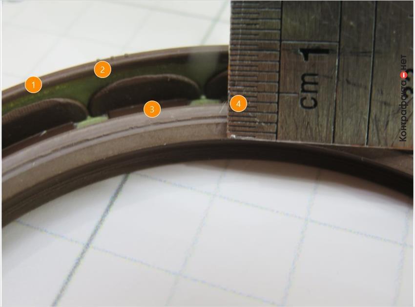 1. Низкое качество обрезинивание армирующего кольца. | 2. Зеленый оттенок металла. | 3. Излишки резины по краю рабочей поверхности. | 4. Рабочая поверхность меньше на 1мм.