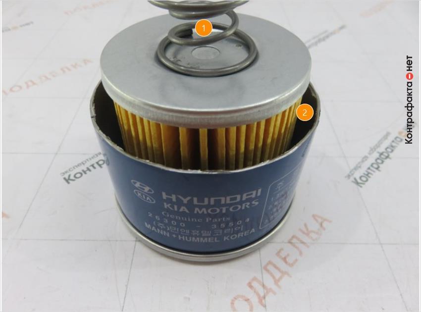 1. Используется пружина вместо прижимной пластины. | 2. Канал между фильтрующим элементом и корпусом больше оригинала.