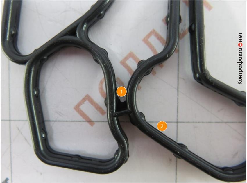 1. Конструктивные отличия. | 2. Многочисленные остатки резины по краям прокладки.