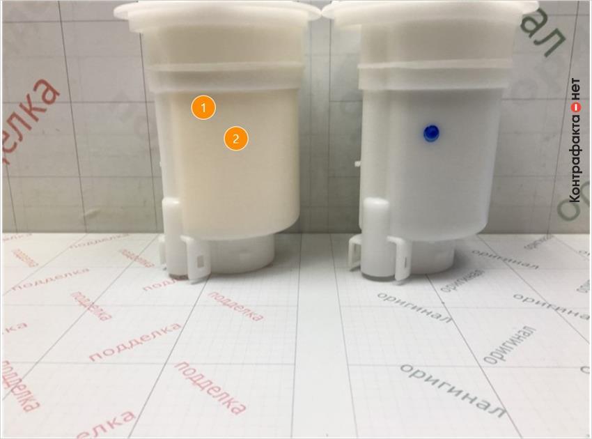 1. Отличается оттенок цвета фильтрующего элемента. | 2. Отсутствует отметка отк.